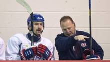 Montreal Canadiens Tomas Plekanec gets a few pointers from assistant coach Gerard Gallant during their training camp Wednesday, Jan. 16, 2013 in Brossard, Que. (Paul Chiasson/THE CANADIAN PRESS)