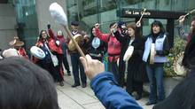 Native women chant outside the court house in Vancouver, British Columbia March 30, 2009. The women where there as defense and prosecution lawyers were in court during an appeal in the case of serial killer Robert Pickton. (Andy Clark/Andy Clark/Reuters)
