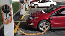 Chevrolet Volt electric vehicles are pictured in Michigan in 2011. General Motors Co. is knocking 13 per cent off the U.S. sticker price of the Chevrolet Volt electric car as it tries to keep pace with rivals in the market for plug-in vehicles. (REBECCA COOK/REUTERS)