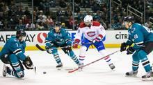 San Jose Sharks defenceman Paul Martin deflects a shot by Montreal Canadiens defenseman P.K. Subban in the second period at SAP Center at San Jose on Feb. 29, 2016. (John Hefti/USA Today Sports)