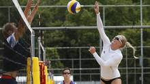 Britain's beach volleyball player Shauna Mullin trains at the London 2012 Olympics beach volleyball venue in central London on July 19. (SUZANNE PLUNKETT/REUTERS)