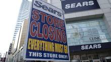A sign announces a closing-down sale at Sears Canada's flagship Toronto store in the Eaton Centre. (Frank Gunn/THE CANADIAN PRESS)