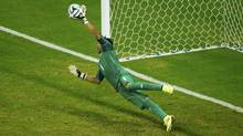 Costa Rica's Keilor Navas saves Greece's Theofanis Gekas' penalty shot a shootout in their 2014 World Cup round of 16 game at the Pernambuco arena in Recife June 29, 2014. (RUBEN SPRICH/REUTERS)