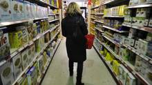 A woman shops for groceries at a store in Toronto's Kensington market. (Fred Lum/The Globe and Mail)