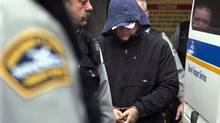 Sub-Lieutenant Jeffrey Paul Delisle is escorted from Provincial Court in Halifax in January. (Andrew Vaughan/The Canadian Press)
