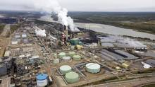 The Suncor processing plant near Athabasca River is shown at their mining operations near Fort McMurray, Alta., in this Sept. 17, 2014 file photo. (Todd Korol/Reuters)