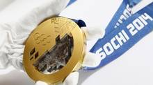 A gold medal manufactured for the 2014 Winter Olympic Games in Sochi, is seen on display at the Adamas jewellery factory in Moscow, June 28, 2013. The factory is the official medal supplier of the 2014 Winter Olympic and Paralympic Games in Sochi. According to the factory, the production of all the series of medals for the 2014 Winter Olympic Games required not less than 3 kilograms of 999 purity gold, 2 tons of 960 purity silver and 700 kilograms of bronze. Picture taken June 28, 2013. (SERGEI KARPUKHIN/REUTERS)