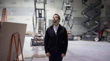 Chris Abraham, artistic director of Crow's Theatre, observes the company's new space on Oct. 20. (Jennifer Roberts for The Globe and Mail)