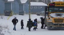Students board a bus last month at Pikangikum First Nation. (Handout/Assembly of First Nations)