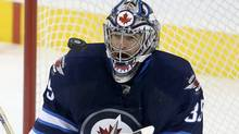 Winnipeg Jets goaltender Al Montoya (35) juggles a New Jersey Devils shot during first period NHL action in Winnipeg, Sunday, October 13, 2013. (Trevor Hagan/THE CANADIAN PRESS)