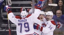Montreal Canadiens forward Andrew Shaw (65) celebrates his game winning goal against the Toronto Maple Leafs with Canadiens forward Tomas Plekanec (14) and defenseman Andrei Markov (79) at the Air Canada Centre on Feb. 25, 2017. Montreal defeated Toronto 3-2 in overtime. (John E. Sokolowski/USA Today Sports)