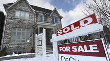 According to the OECD, close to four in 10 Canadians live in a city where house prices are 'seriously or severely unaffordable.' (Fred Lum/The Globe and Mail)