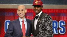 NBA Commissioner Adam Silver, left, congratulates Andrew Wiggins of Kansas who was selected by the Cleveland Cavaliers as the number one pick in the 2014 NBA draft, Thursday, June 26, 2014, in New York. (Associated Press)