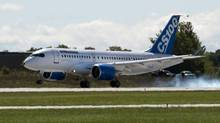 Bombardier's C-Series100 touches down after its maiden test flight September 16, 2013 in Mirabel, Que. (Ryan Remiorz/THE CANADIAN PRESS)