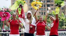 (L-R) Gabriela Dabroswski, Eugenie Bouchard, Sharon Fichiman and Stephanie Dubois of the Canadian team celebrates winning its FedCup Americas Zone tennis match against Brazil in Medellin February 9, 2013. (ALBEIRO LOPERA/REUTERS)
