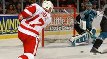 Detroit Red Wings' Brett Hull scores his 700th career goal past San Jose Sharks goalie Evgeni Nabokov in the second period in Detroit on Feb. 10, 2003. (DAVID GURALNICK)