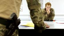 Prince Harry attends a mission briefing in the British controlled flight-line in Camp Bastion southern Afghanistan. The Prince, who is serving as a pilot/gunner with 662 Squadron Army Air Corps, is on a posting to Afghanistan that runs from September, 2012 to January, 2013. (POOL/REUTERS)