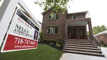 """A """"for sale"""" sign is seen outside a home in New York June 19, 2012. U.S. housing starts rose to 760,000 in June, at an annualized pace, up 6.9 per cent from May. (SHANNON STAPLETON/REUTERS)"""