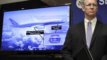 John DeLisi, director of the National Transportation Safety Board (NTSB) Office of Aviation Safety stands beside a slide shown at a news conference in Washington Feb. 7, 2013. (YURI GRIPAS/REUTERS)