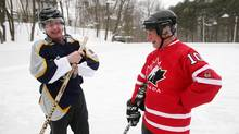 Roy MacGregor, left, gives a few hockey pointers to Canadian Governor-General David Johnston at Rideau Hall. (Dave Chan for The Globe and Mail)
