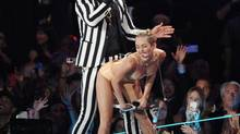 There was outrage after Miley Cyrus performed with Robin Thicke at the MTV Video Music Awards, as if their raunchy simulated sex was something new to pop music videos. (Scott Gries/AP)