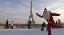 GETTING HIS SKATES ON: A man dressed as Santa Claus limbers up for Christmas in Paris. (JACKY NAEGELEN/REUTERS)