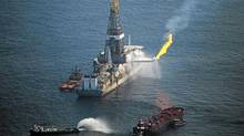 A flare burns from a drill ship recovering oil from the ruptured BP oil well in the Gulf of Mexico. (Spencer Platt/Getty Images)