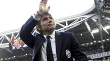Juventus coach Antonio Conte waves to supporters during a Serie A soccer match between Juventus and Livorno (Massimo Pinca/AP)