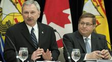 New Brunswick Finance Minister Blaine Higgs (left) and Transportation Minister Claude Williams attend a prebudget news conference March 22. (David Smith-MDS Photography/THE CANADIAN PRESS)