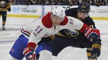 Montreal Canadiens forward Brendan Gallagher skates past Buffalo Sabres defenseman Zach Bogosian during the second period of an NHL hockey game in Buffalo, N.Y., on April 5, 2017. (Jeffrey T. Barnes/AP)