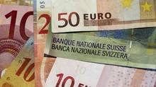 Euro and Swiss Franc notes are seen in this illustration picture in Lausanne August 9, 2011. (DENIS BALIBOUSE)