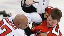 Ottawa Senators' Chris Neil, right, fights with Washington Capitals' Donald Brashear in Ottawa in 2007. (Sean Kilpatrick/The Canadian Press)