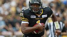 Tiger-Cats' quarterback Henry Burris will be gunning for his third Grey Cup Ring Sunday, and first since he left Calgary. (DAVE CHIDLEY/THE CANADIAN PRESS)
