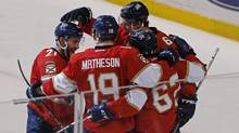 Florida Panthers players celebrate their overtime win over the New York Islanders with center Denis Malgin (62) who scored the winning goal in an NHL hockey game, Saturday, Nov. 12, 2016, in Sunrise, Fla. (Joe Skipper/AP)