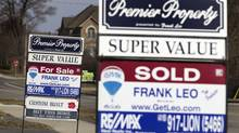 File photo of various real estate signs advertising homes for sale, or sold, in Toronto. (Peter Power/The Globe and Mail)