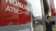 A man walks out from a Nomura Securities branch in Tokyo. (YURIKO NAKAO/REUTERS)