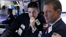 Traders work on the floor at the New York Stock Exchange on Tuesday, March 6, as stocks suffered their biggest losses of the year. (Seth Wenig/Seth Wenig/AP)