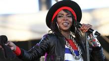 This April 15, 2011, file photo shows singer Lauryn Hill performing during the Coachella Valley Music and Arts Festival in Indio, Calif. (Spencer Weiner/AP)