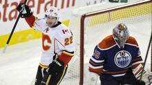 Calgary Flames' Lee Stempniak (L) celebrates a goal by teammate Blake Comeau (not pictured) against Edmonton Oilers' goalie Nikolai Khabibulin (R) during the first period of their NHL hockey game in Edmonton January 21, 2012. (DAN RIEDLHUBER/REUTERS)