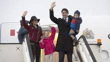 Justin Trudeau arrives in Luton, England, last month with wife Sophie Gregoire Trudeau,daughter Ella-Grace and son Hadrien. (Adrian Wyld/THE CANADIAN PRESS)