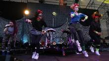 Canadian singer-songwriter Grimes, second from right, performs in Auckland, New Zealand, on Feb. 1. (Fiona Goodall/Getty Images)