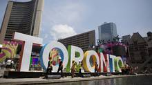 Workers prepare for the Pan Am Games in Toronto's Nathan Phillips Square on July 8, 2015. (Rebecca Blackwell/THE ASSOCIATED PRESS)
