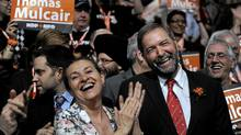 NDP leadership candidate Thomas Mulcair received 43.8 per cent of the third ballot votes. Mulcair's wife Catherine Pinhas is on his right. (Fred Lum/The Globe and Mail/Fred Lum/The Globe and Mail)