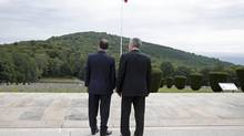 "French President Francois Hollande, left, and German President Joachim Gauck attend a ceremony to commemorate the centenary of the start of World War One (WWI) at the Vieil Armand ""Hartmannswillerkopf"" battlefield in the Alsace region, Aug. 3. (CHRISTIAN HARTMANN/REUTERS)"
