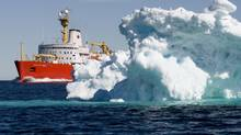 The Canadian Coast Guard icebreaker Louis S. St-Laurent sails past a iceberg in Lancaster Sound in the Northwest Passage. (JONATHAN HAYWARD/THE CANADIAN PRESS)