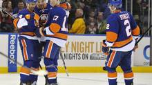 New York Islanders' Mark Streit (2) skates in to celebrate Radek Martinek's (4) goal with Jesse Joensuu (6) and Matt Martin (17) in the second period of an NHL hockey game against the Florida Panthers on Tuesday, April 16, 2013, at Nassau Coliseum in Uniondale, N.Y. (Kathy Kmonicek/AP)