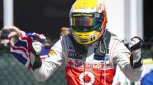 Lewis Hamilton celebrates his victory at the Canadian Grand Prix. (Paul Chiasson/THE CANADIAN PRESS)