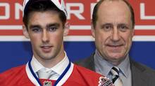 Montreal Canadiens draft pick Louis Leblanc poses for a photo with general manager Bob Gainey looks on at the 2009 NHL entry draft Friday, June 26, 2009 in Montreal. THE CANADIAN PRESS/Ryan Remiorz (Ryan Remiorz)