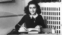 Anne Frank at a desk (AP Photo/Yad Vashem Photo Archive)