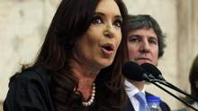 Argentina's President Cristina Fernandez de Kirchner speaks next to Vice-President Amado Boudou during the opening session of Congress in Buenos Aires, March 1, 2013. (MARCOS BRINDICCI/REUTERS)